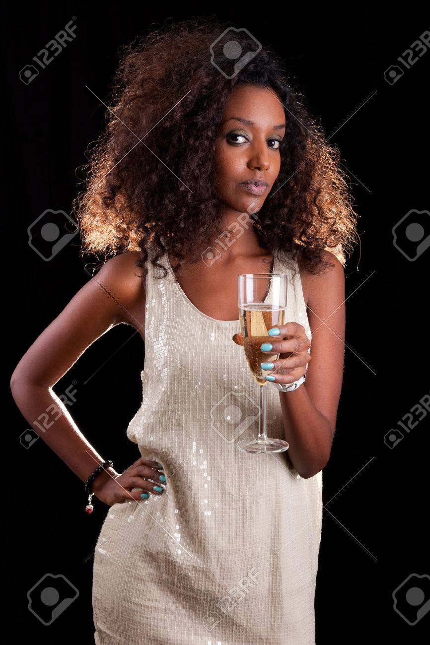 Young beautiful African American woman holding a glass of champagne Stock Photo - 10985494