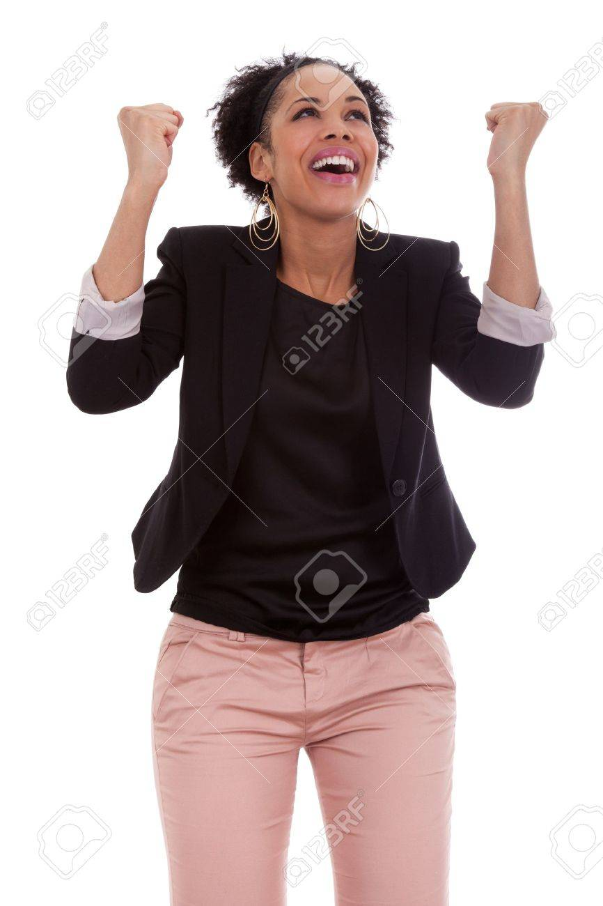 African american woman celebrating success with clenched fists on white background Stock Photo - 11551444