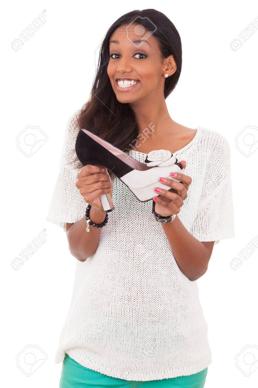 Happy  african american woman holding a high heel shoe in her hands Stock Photo - 13714326