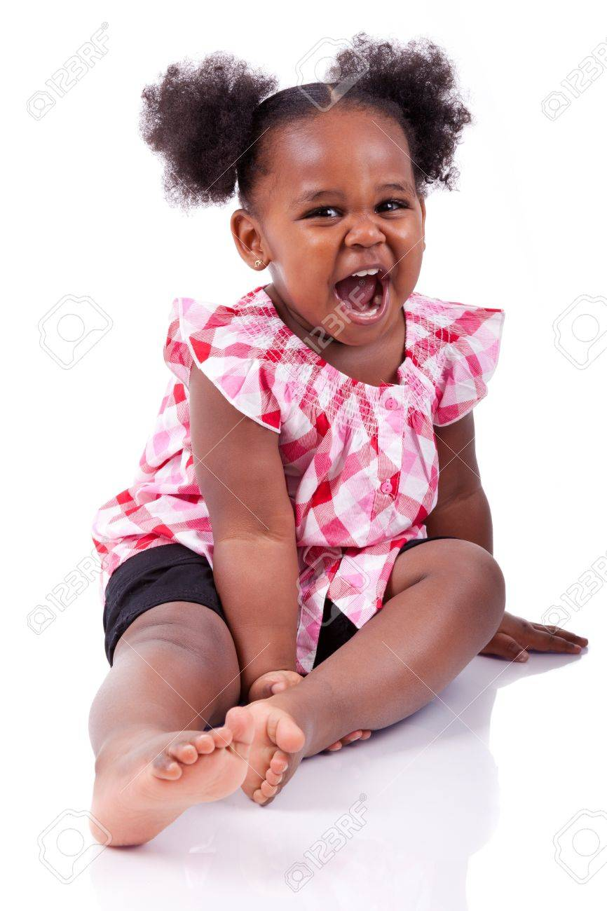 Cute little african american girl laughing, isolated on white background Stock Photo - 14132431