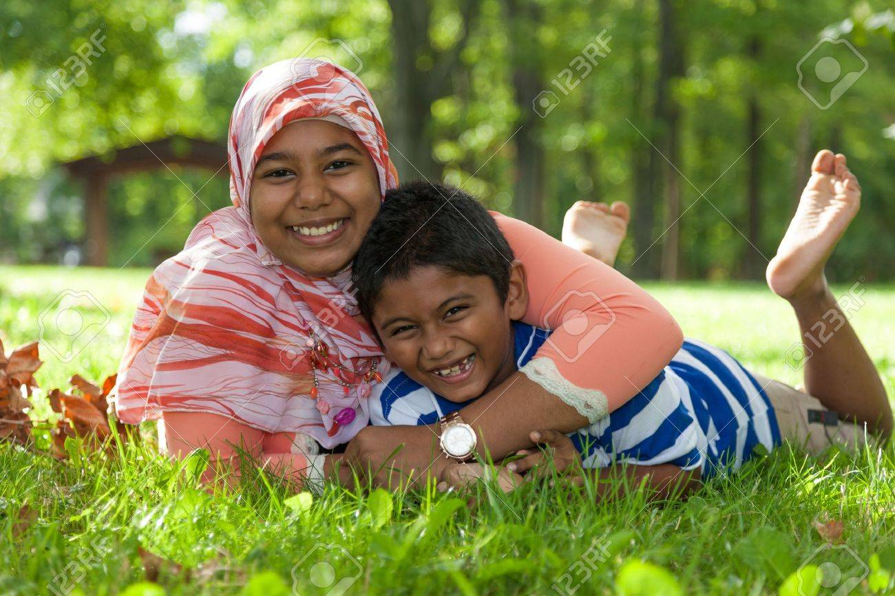Outdoor portrait of indian brother and sister playing Stock Photo - 15531204