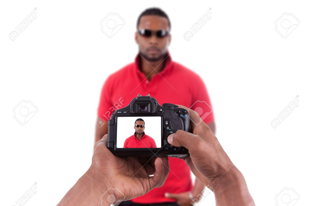 African american photographer taking studio pictures of a young black man Stock Photo - 15896252