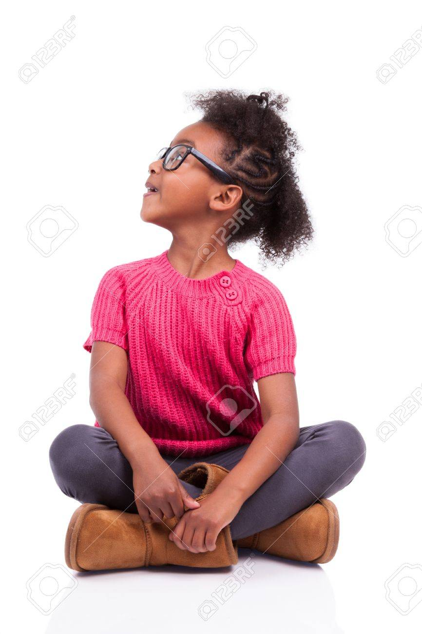 Portrait of a cute young African American girl seated on the floor Stock Photo - 16116359