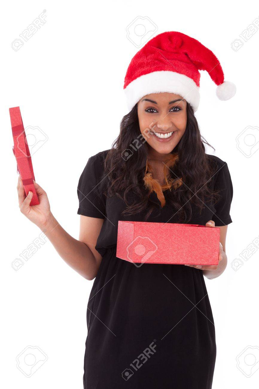 Young African American woman wearing a santa hat opening a gift box, isolated on white background Stock Photo - 16640763