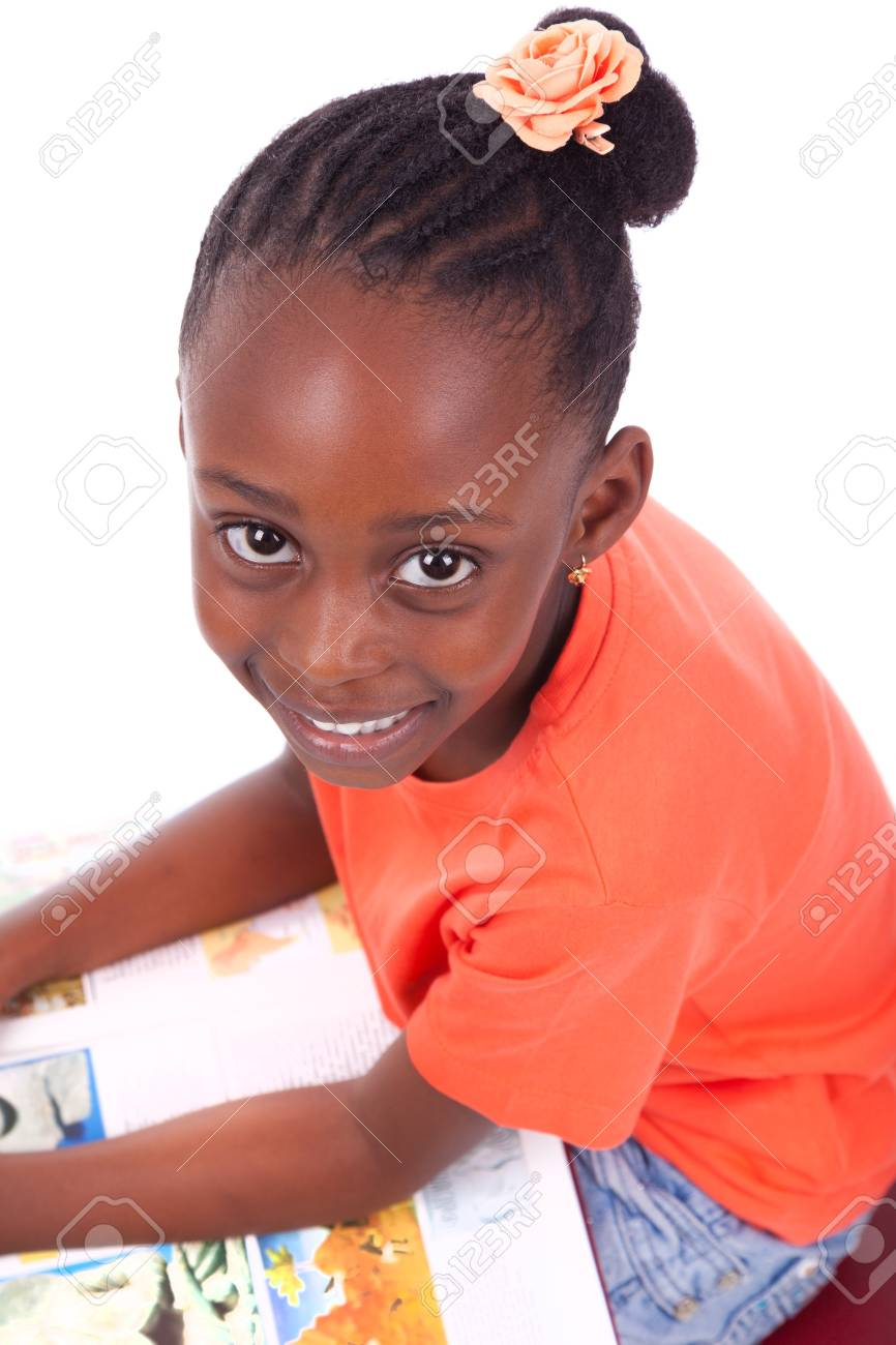 Cute black african american little girl reading a book, isolated on white background - African people - Children Stock Photo - 19665337