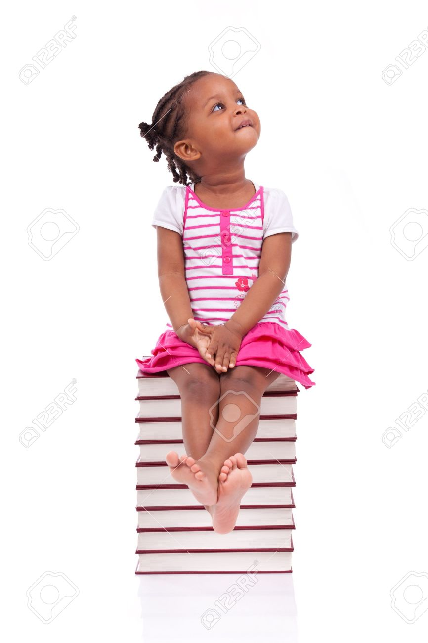 Cute black african american little girl seated in a stack of books, isolated on white background - African people - Children Stock Photo - 19665261