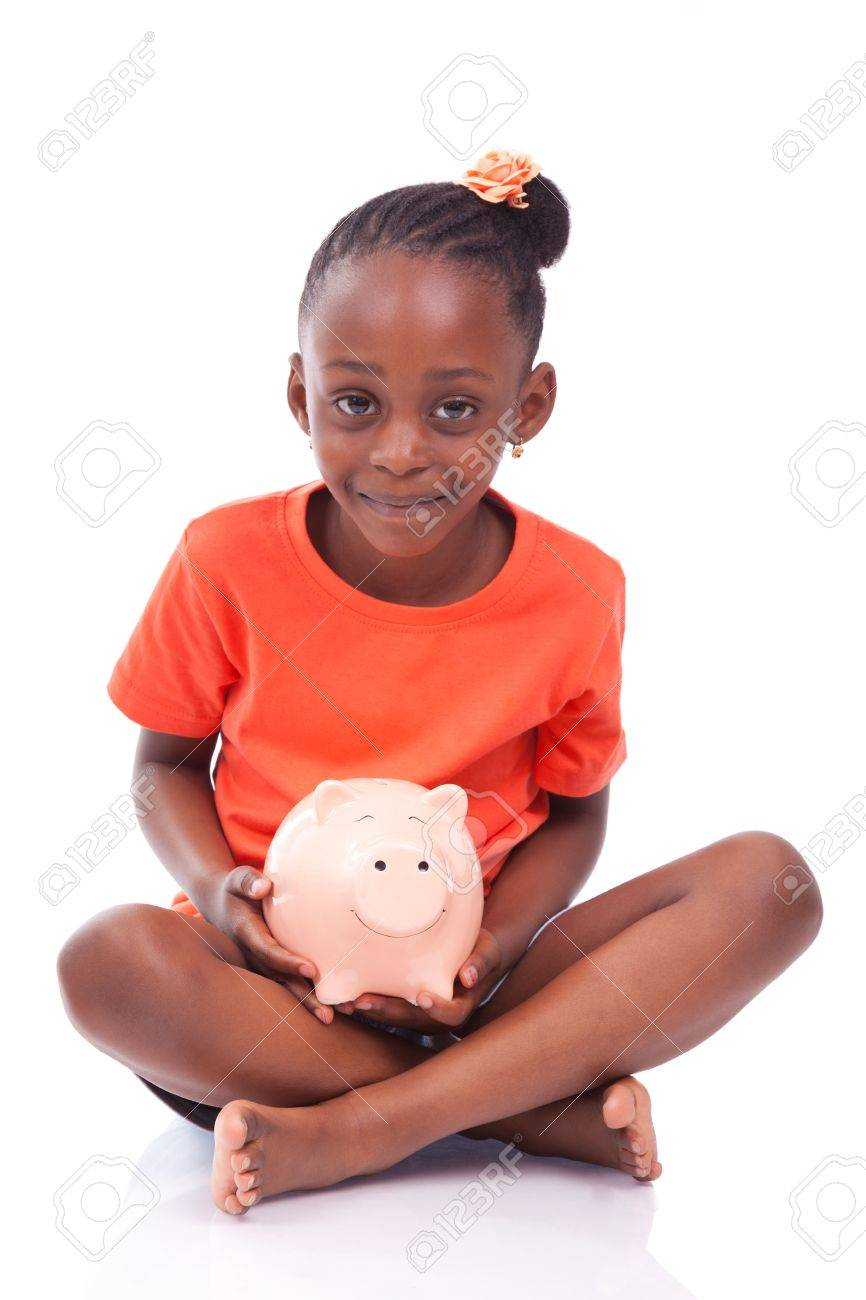 Cute little black girl holding a smiling piggy bank isolated on white background african