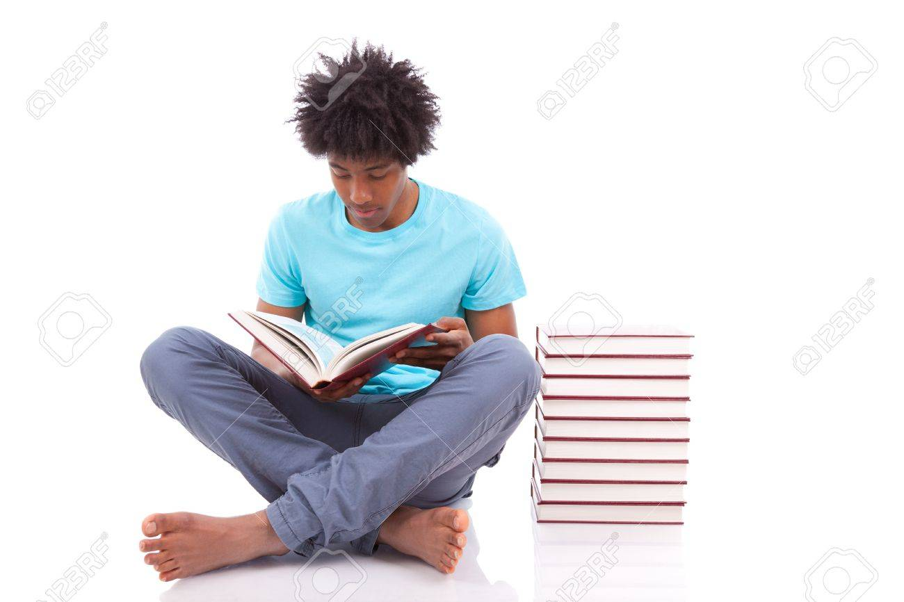 Young Black Teenage Student Men Reading A Books, Isolated On ...