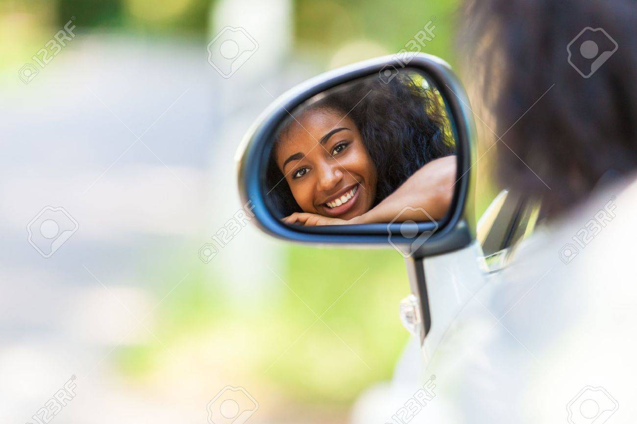 Young black teenage driver seated in her new convertible car - African people Stock Photo - 21656406