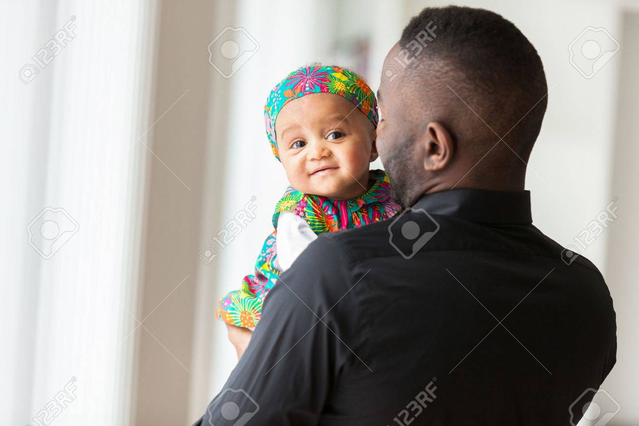 Young african american father holding with her baby girl Stock Photo - 38271600