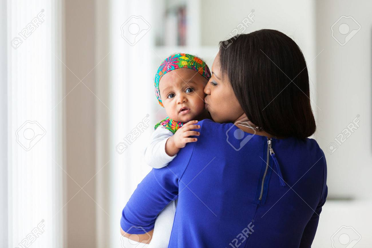 Young african american mother playing with her baby girl Stock Photo - 38271603
