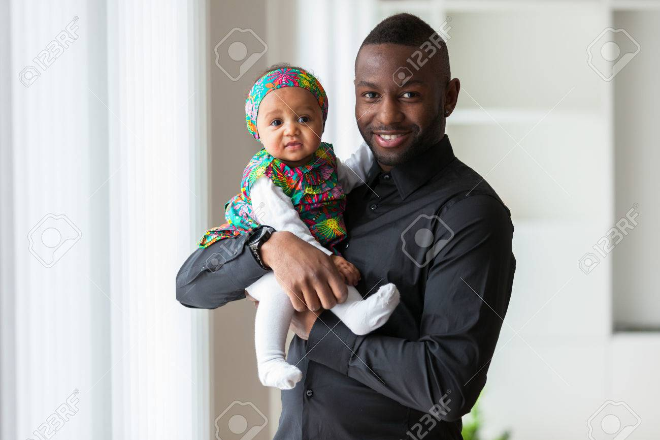 Young african american father holding with her baby girl Stock Photo - 38705597