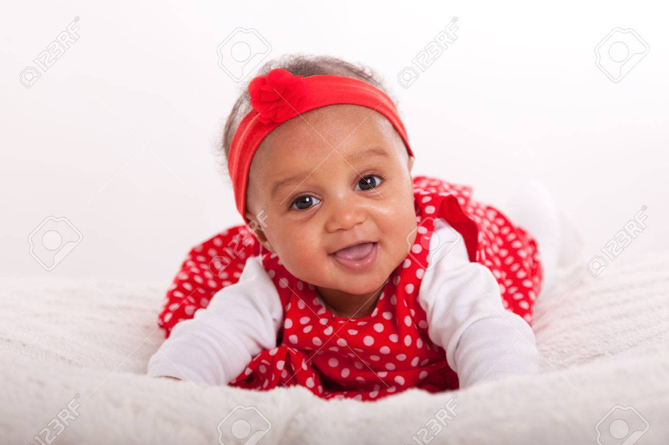 Portrait of little African American little girl smiling - Black people Stock Photo - 38705613