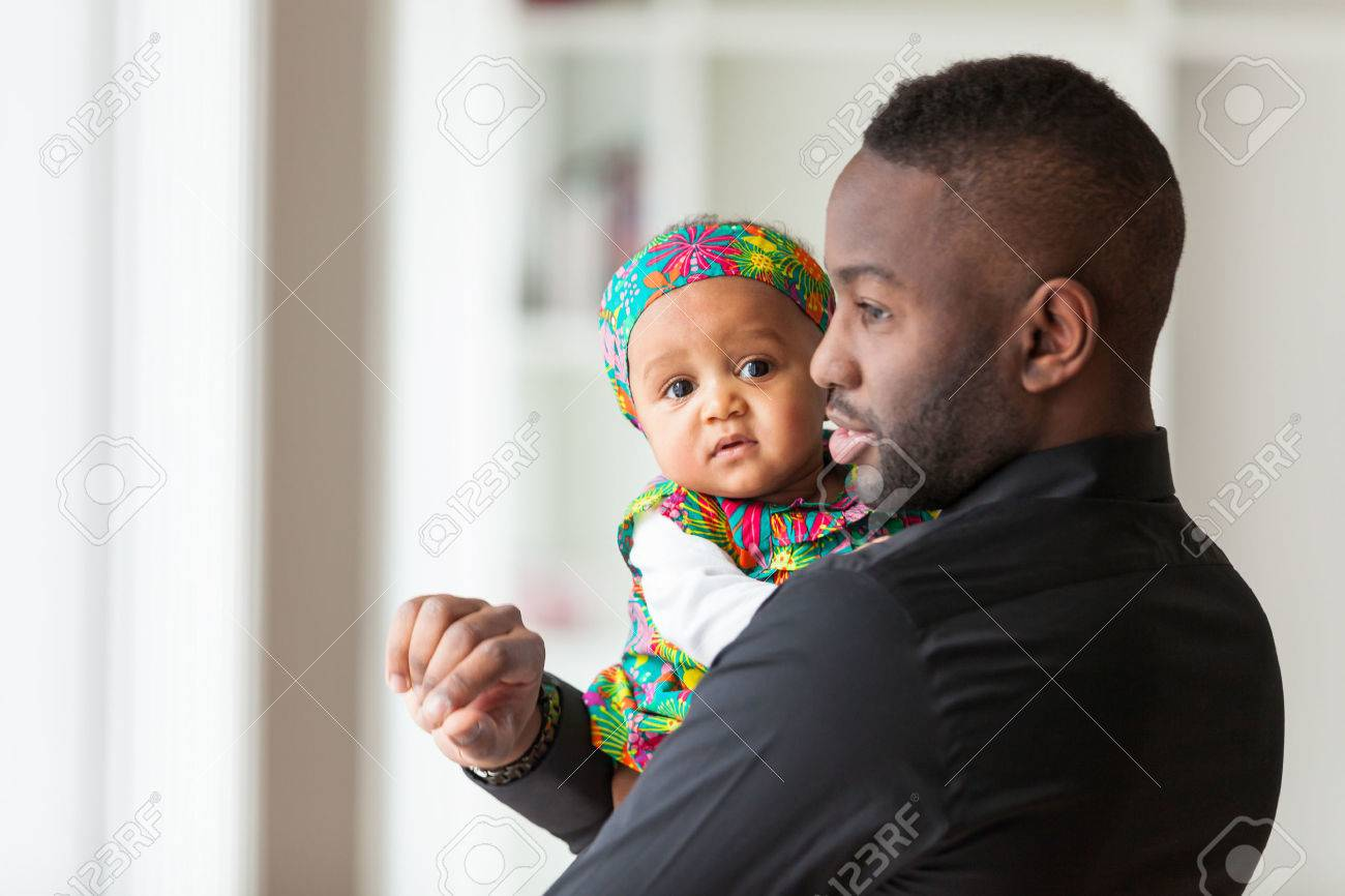 Young african american father holding with her baby girl Stock Photo - 38705618