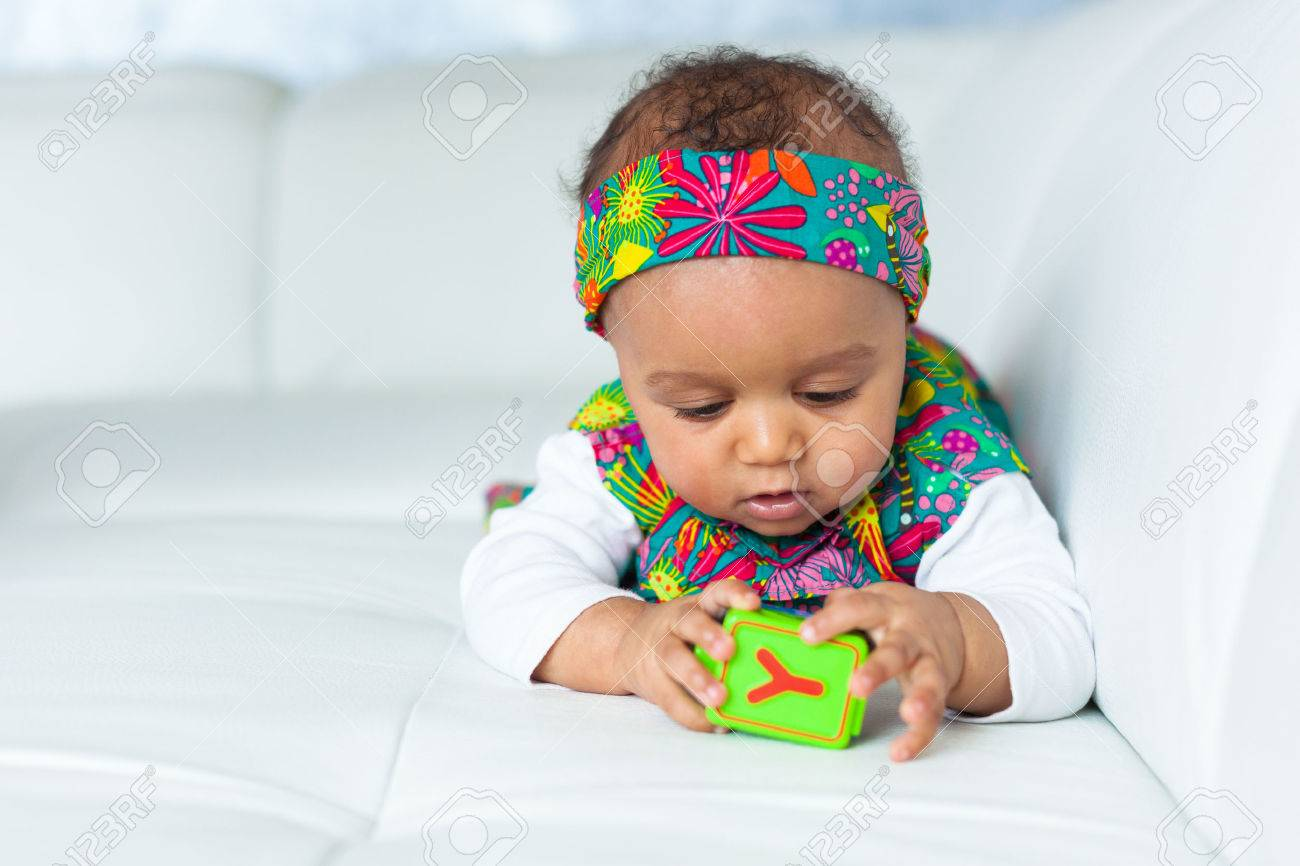 Portrait of little African American little girl playing - Black people Stock Photo - 38705634