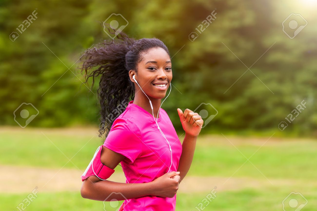 African american woman runner jogging outdoors - Fitness, people and healthy lifestyle Stock Photo - 43561065