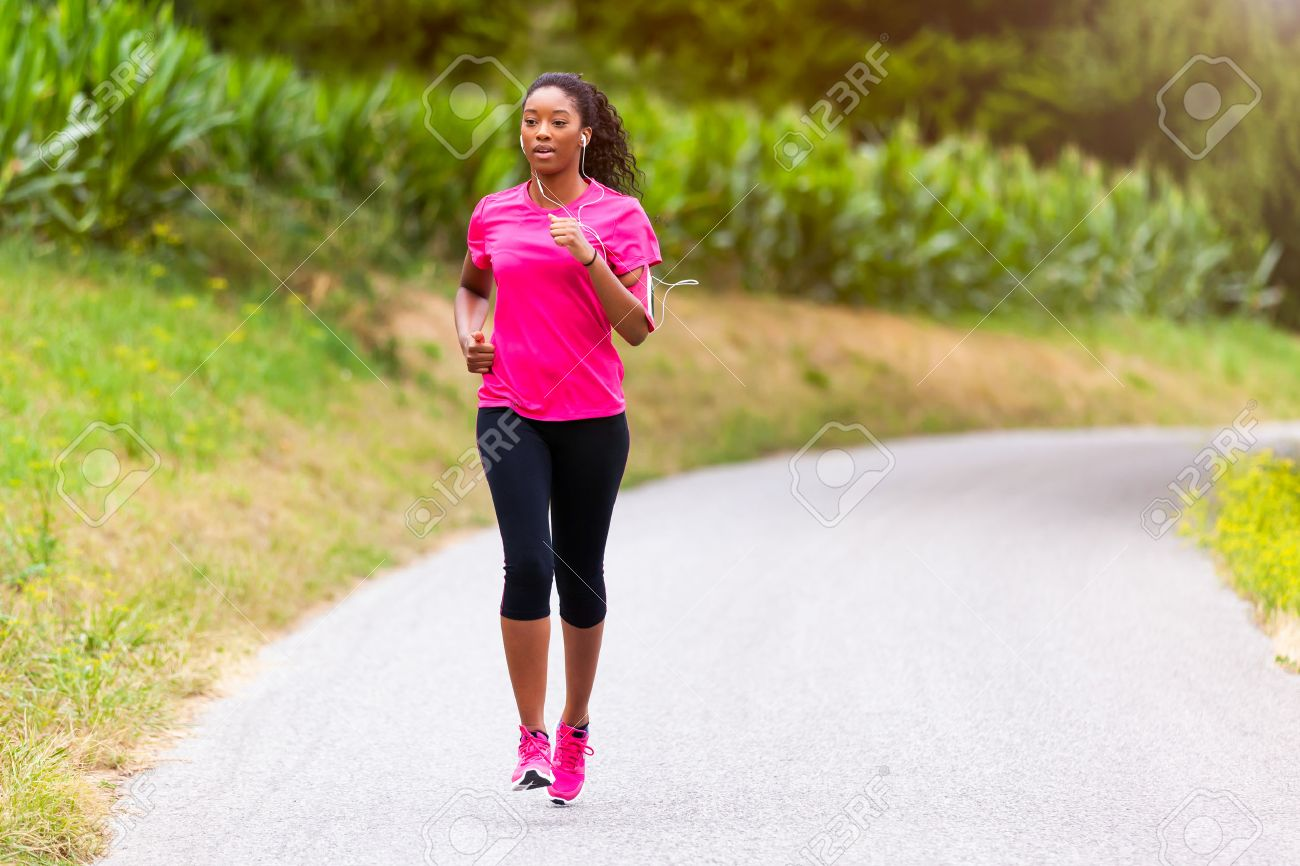 African american woman runner jogging outdoors - Fitness, people and healthy lifestyle Stock Photo - 43561066