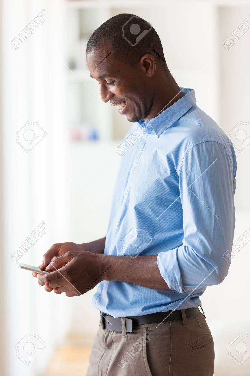 Portrait of a young African American business man using a mobile phone - Black people Stock Photo - 43561072