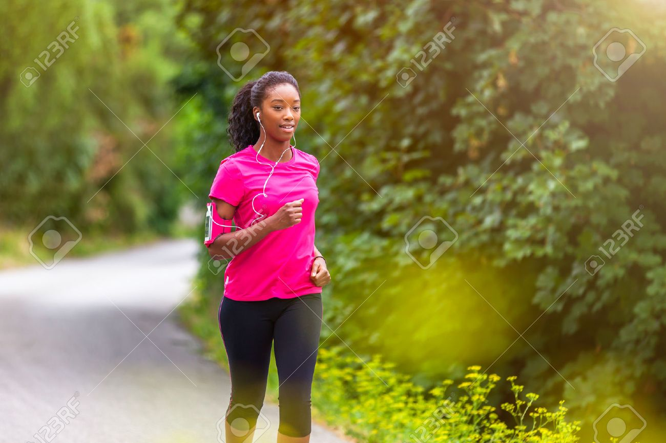 African american woman runner jogging outdoors - Fitness, people and healthy lifestyle - 43561080