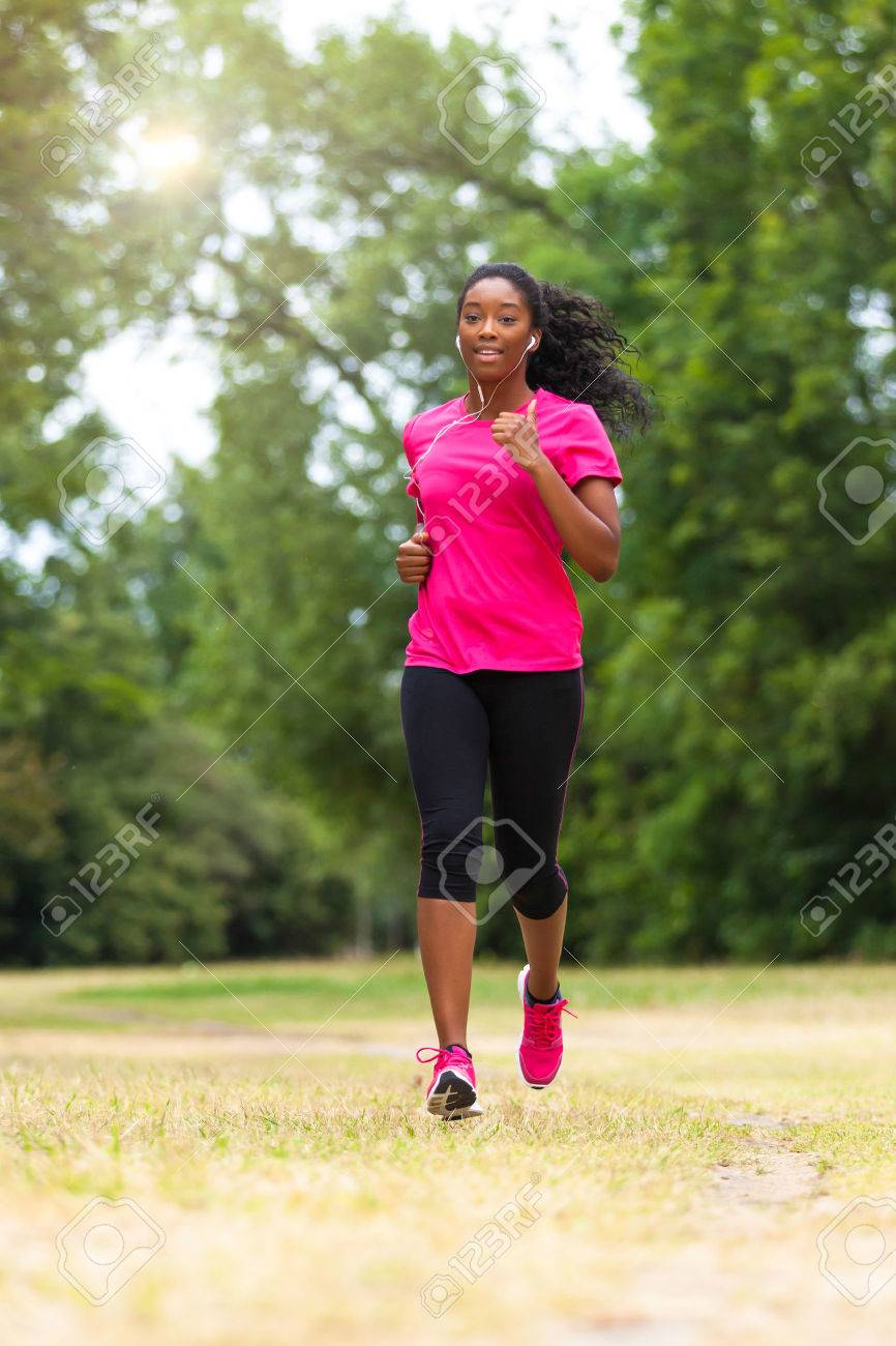 African american woman runner jogging outdoors - Fitness, people and healthy lifestyle Stock Photo - 43561523