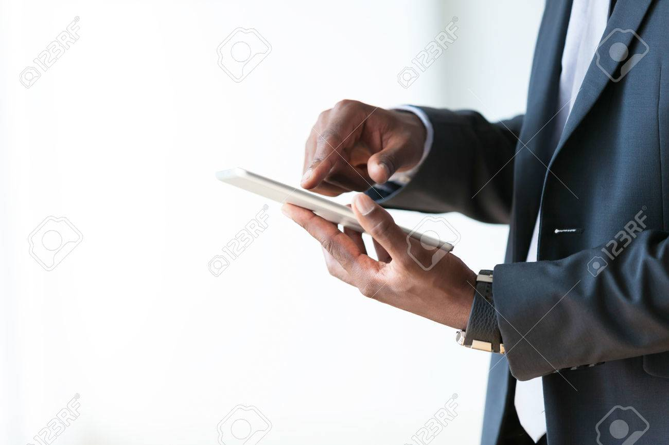 African american business man using a tactile tablet over white background - Black people - 43561640
