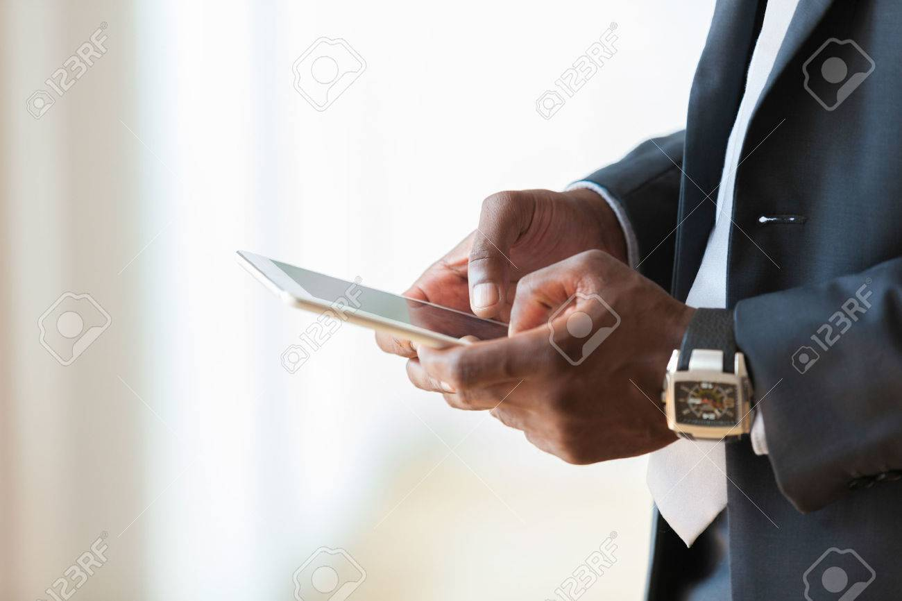 African american business man using a tactile tablet over white background - Black people - 43729022
