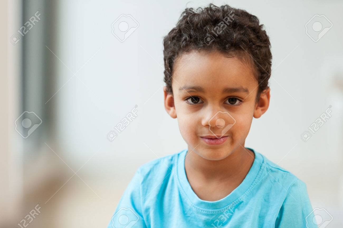 Portrait of a cute little African American boy smiling - 45736498