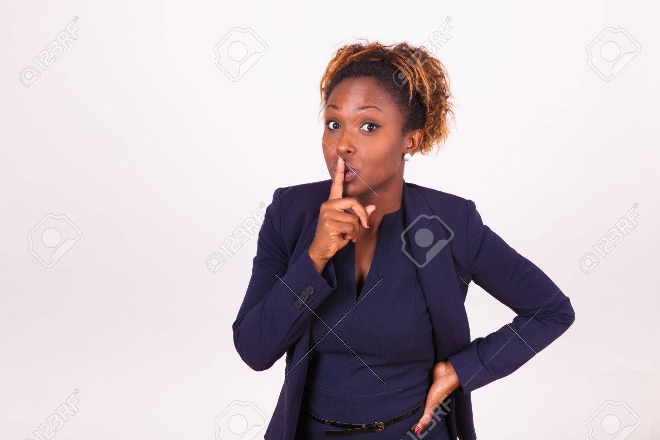 African American business woman making silence gesture with her finger - 47855426