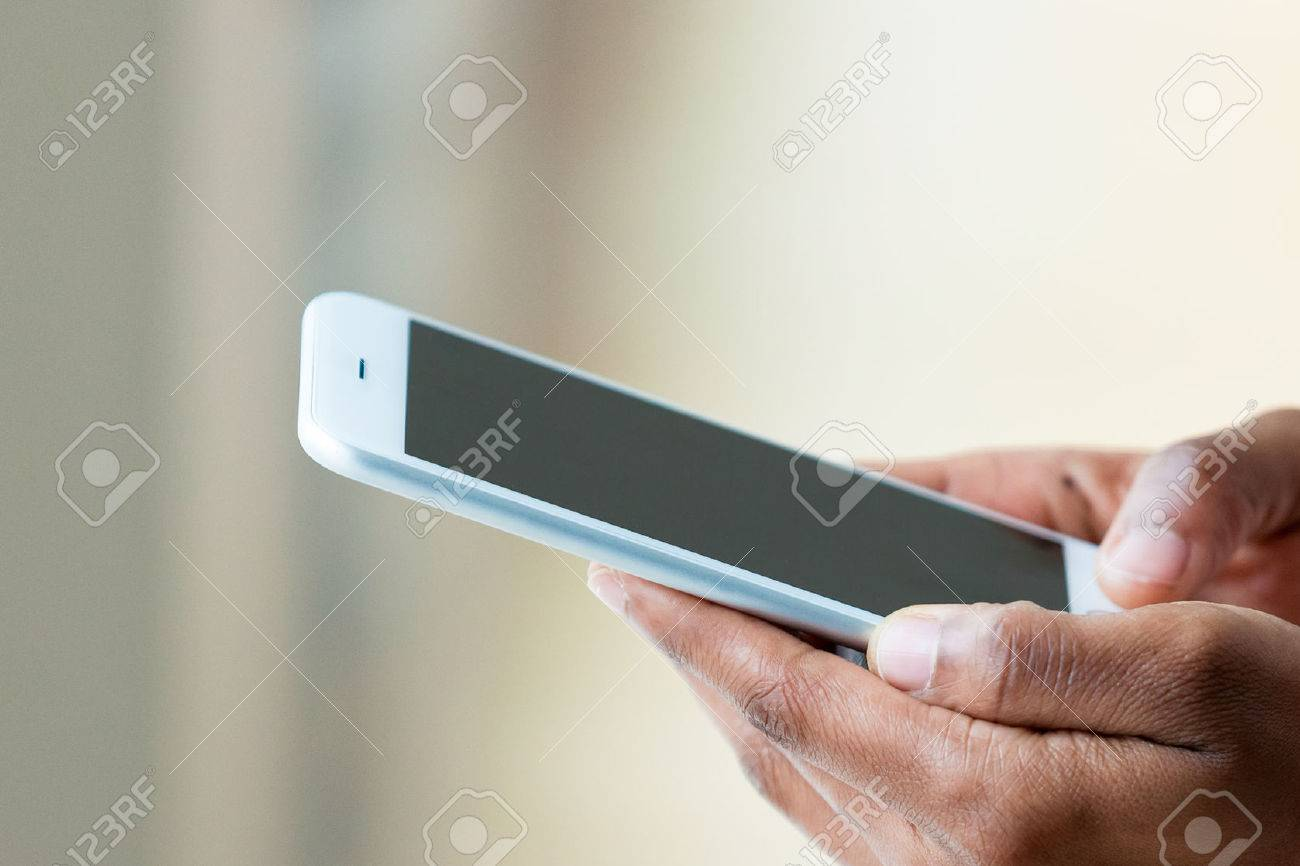 African american person holding a tactile mobile smartphone - Black people - 51547385