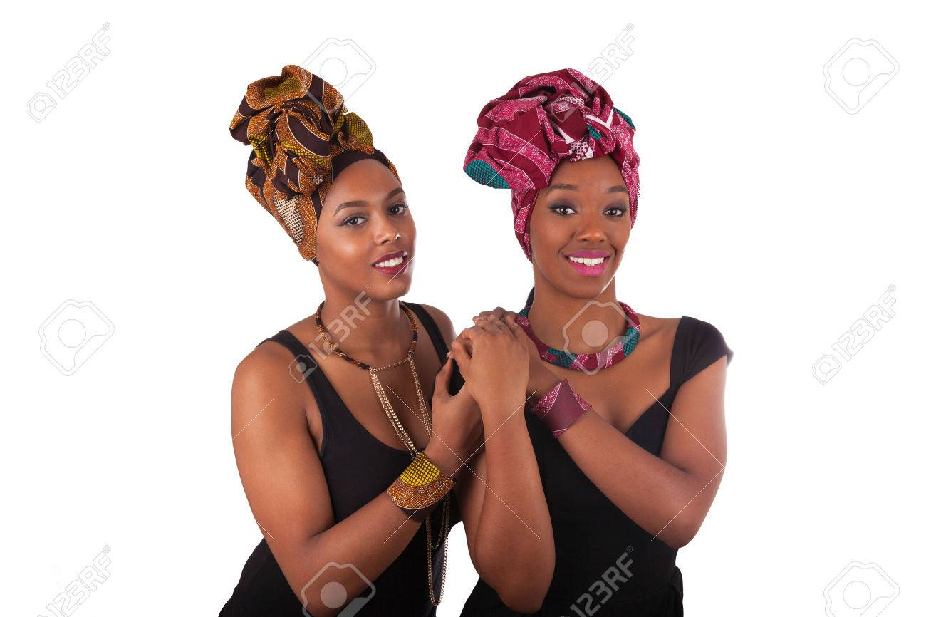 Young beautiful african womans wearing a traditional headscarf - 55796910
