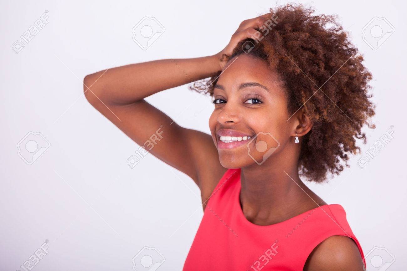Young African American woman holding her frizzy afro hair - Black people - 58415835