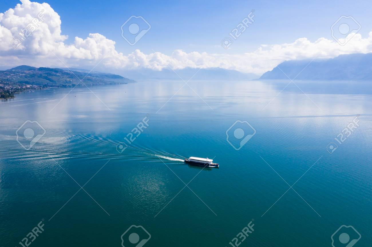 Aerial view of boat leaving Ouchy waterfront in Lausanne, Switzerland - 111831542