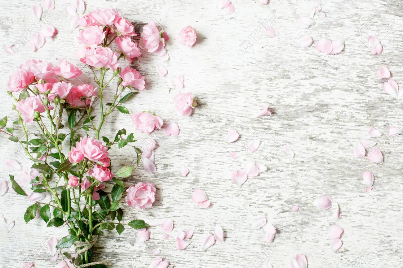 Pink Rose Flowers Bouquet Mockup On White Rustic Wooden Background Stock Photo Picture And Royalty Free Image Image 95484723