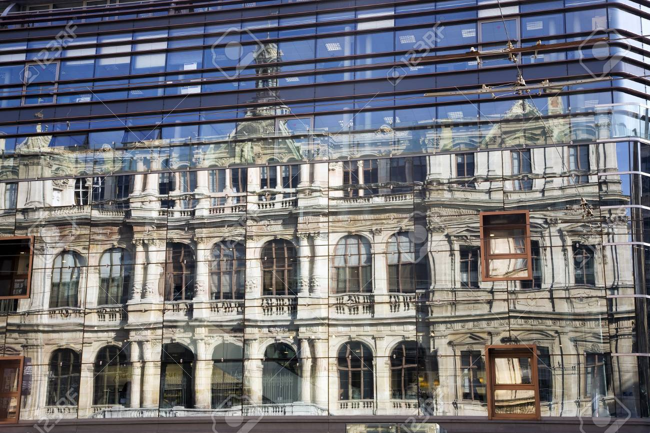 The Chambre de Commerce building in Lyon reflected in the window..