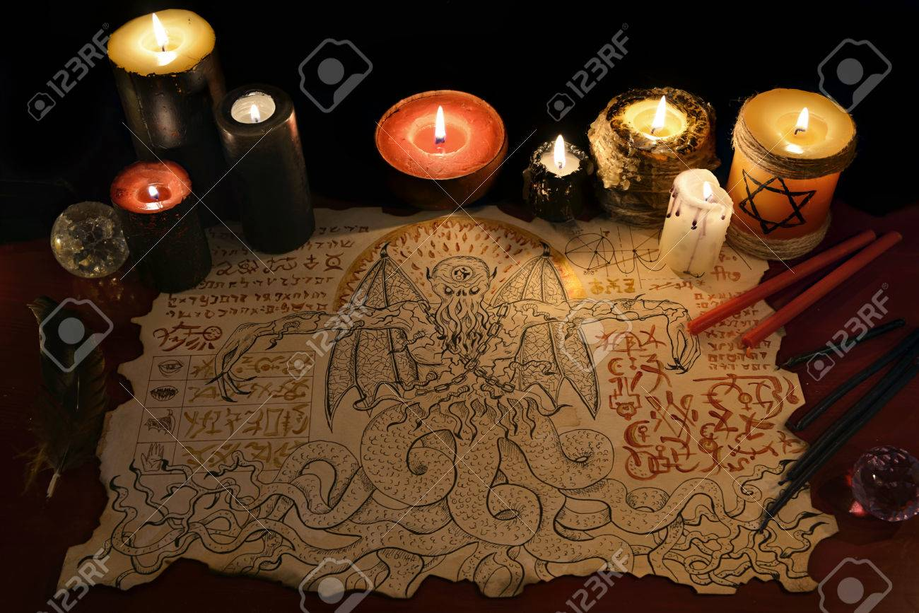 Black magic ritual or spell with demon manuscript and evil candles black magic ritual or spell with demon manuscript and evil candles halloween concept occult buycottarizona Gallery