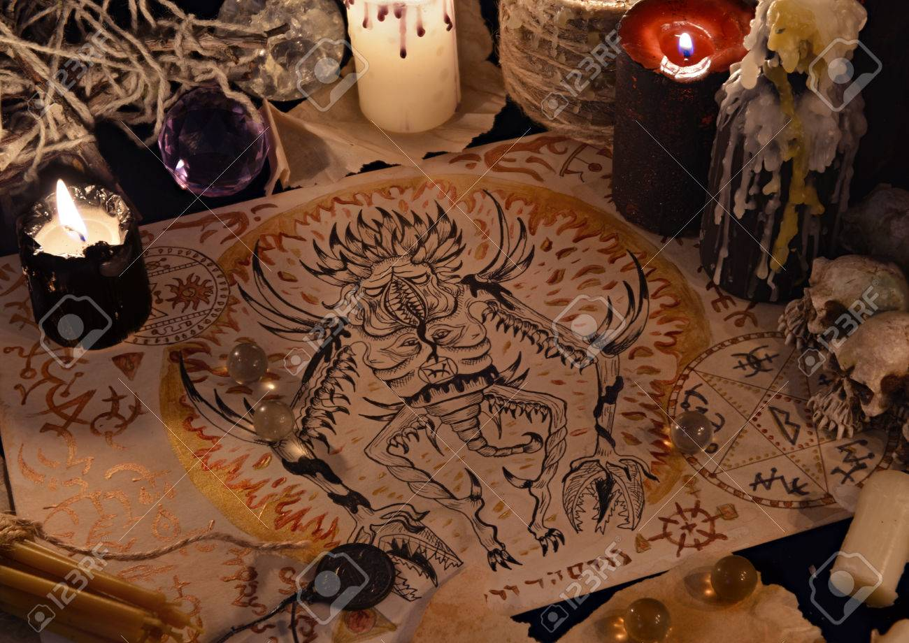 Close up of demon drawing on old parchment and magic ritual objects close up of demon drawing on old parchment and magic ritual objects halloween concept buycottarizona Gallery
