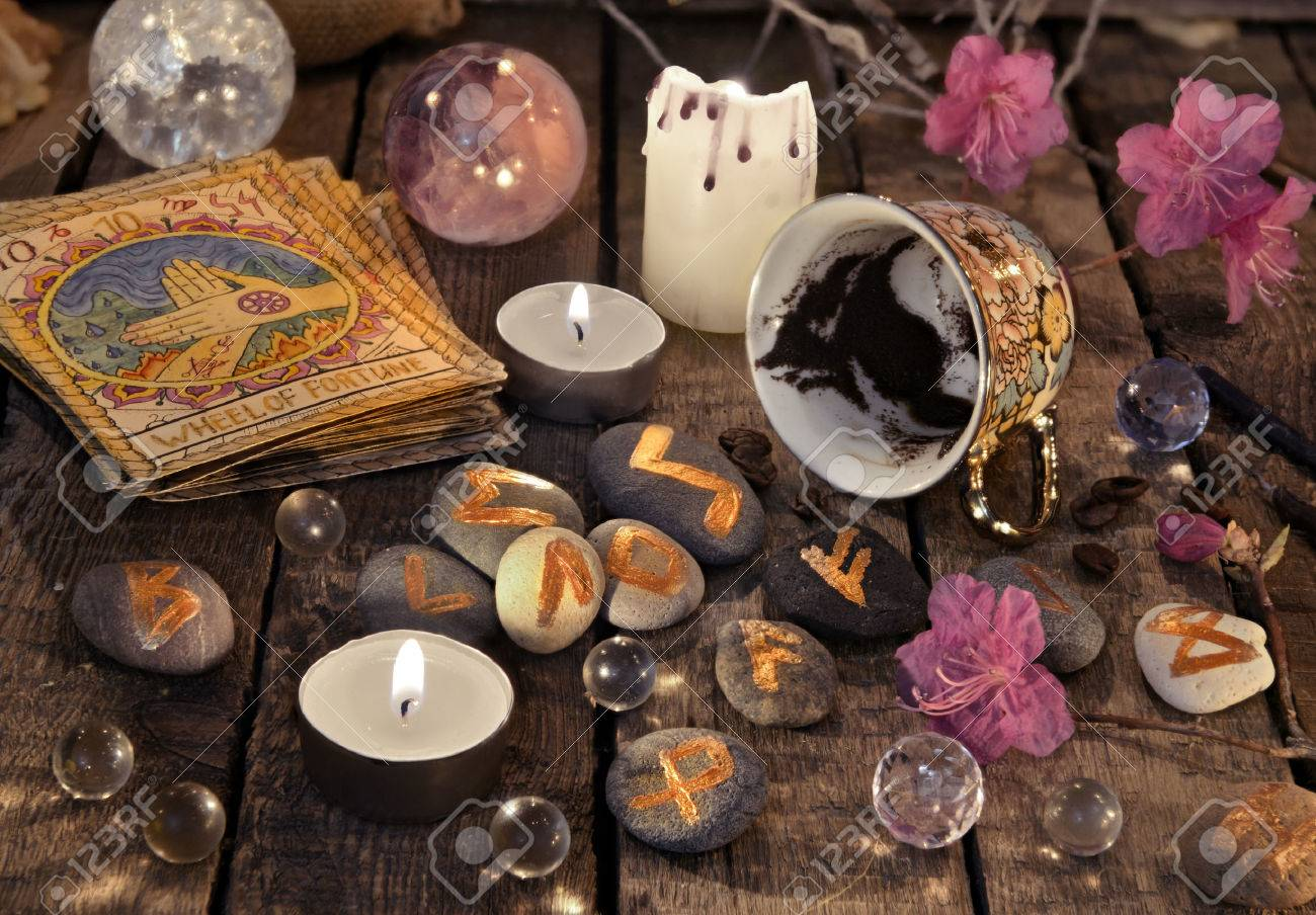 Mystic still life with coffee grounds, tarot cards and stone runes. Halloween background, coffee reading ritual, occult and esoteric objects on witch table - 78663788