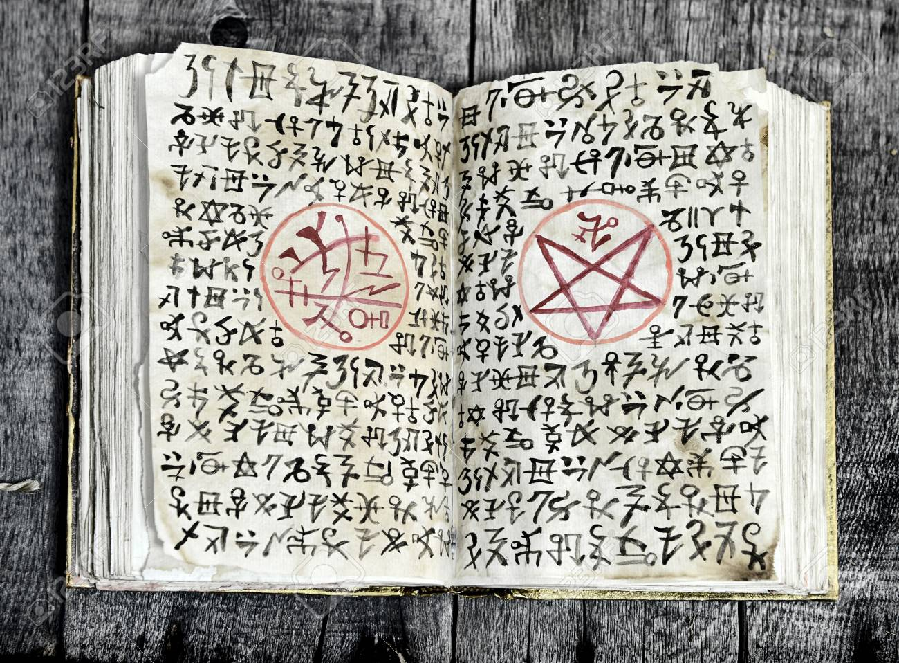 Open Black Magic Book With Evil Symbols And Pentagram On Shabby Stock Photo Picture And Royalty Free Image Image 95720560