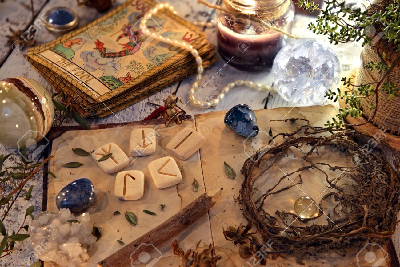 Open diary book with runes, dried herbs and tarot cards on table. Magic gothic ritual. Wicca, esoteric and occult background with vintage objects - 113292809