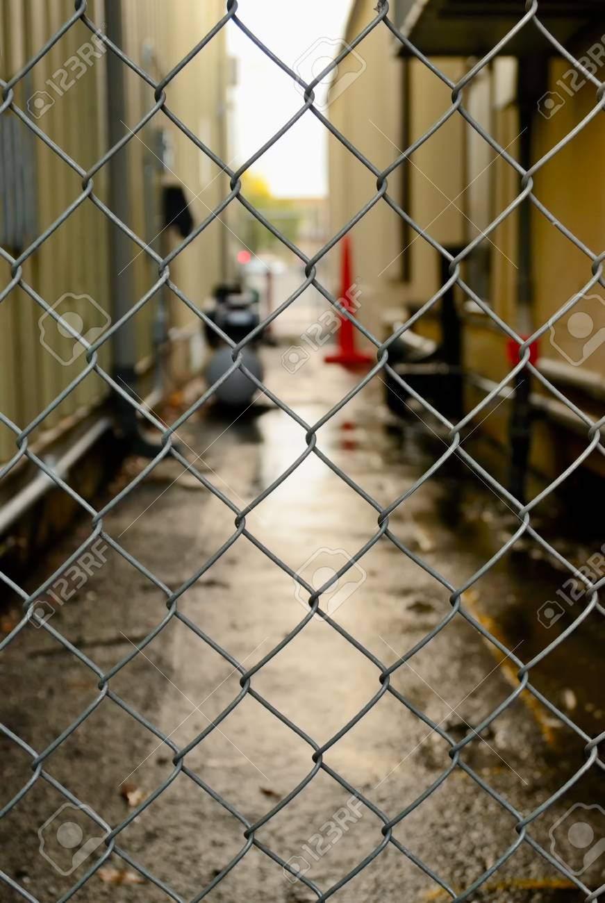 Fence and blurry by-street on the background Stock Photo - 17178458