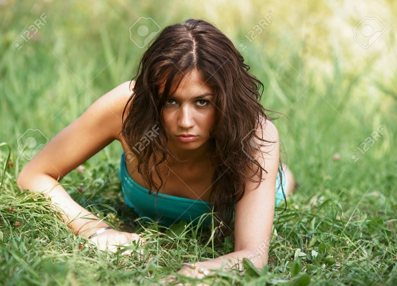 The beautiful girl on a green grass Stock Photo - 13335753