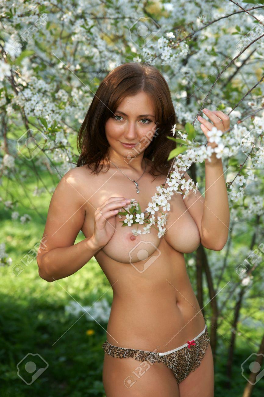 A Nude Girl In A Cherry Garden Stock Photo 13402175