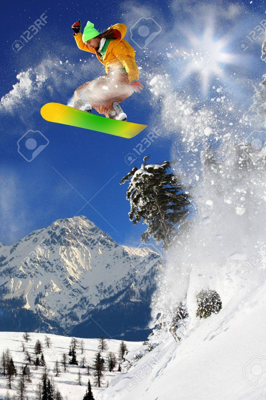 Snowboarders jumping against blue sky Stock Photo - 12021231