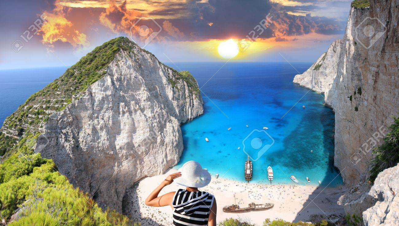 Navagio beach with woman on cliff, Zakynthos Island, Greece Stock Photo - 13006484