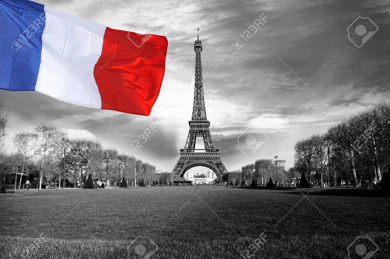 Eiffel Tower with flag of France in Paris city - 15549659