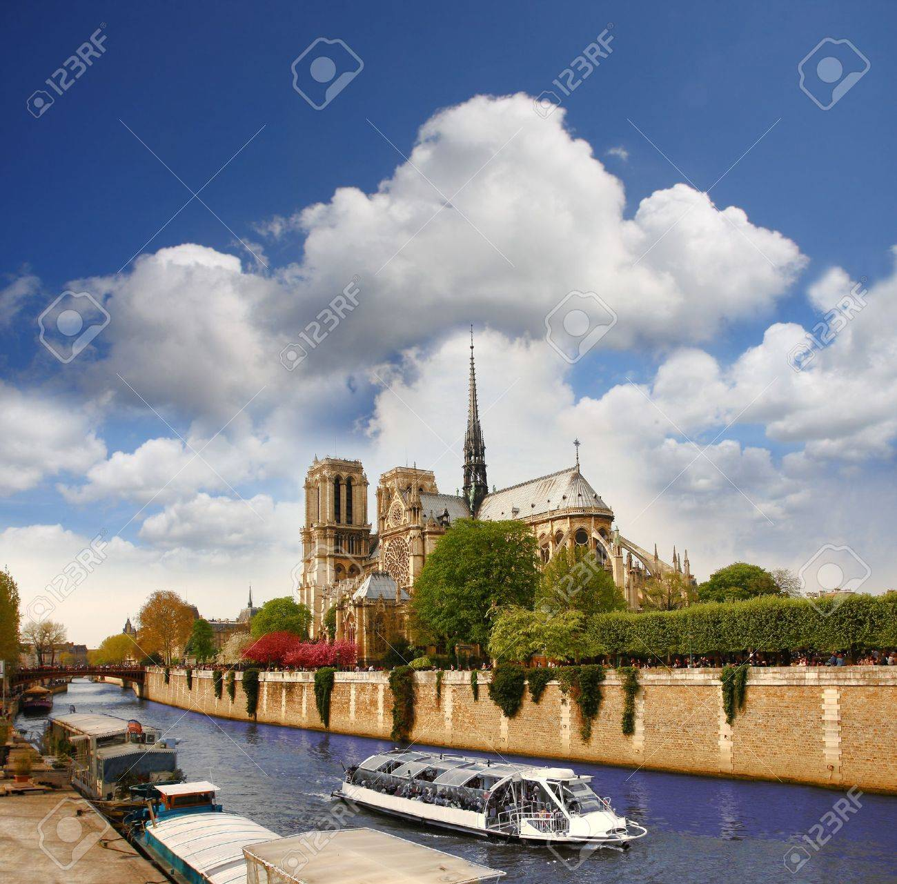 Paris, Notre Dame with boat on Seine, France - 15421415