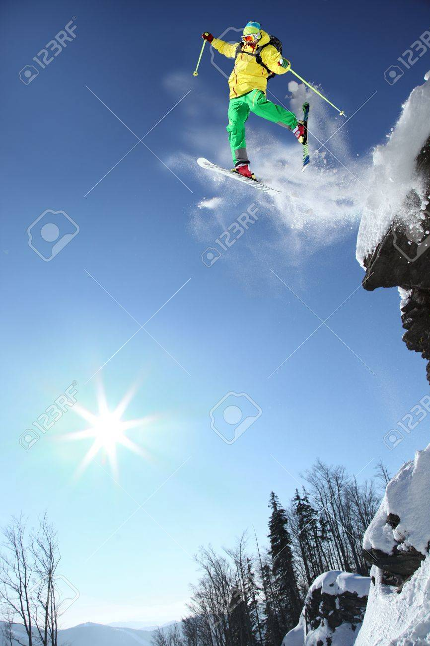 Skier jumping through the air from the rock - 15622098