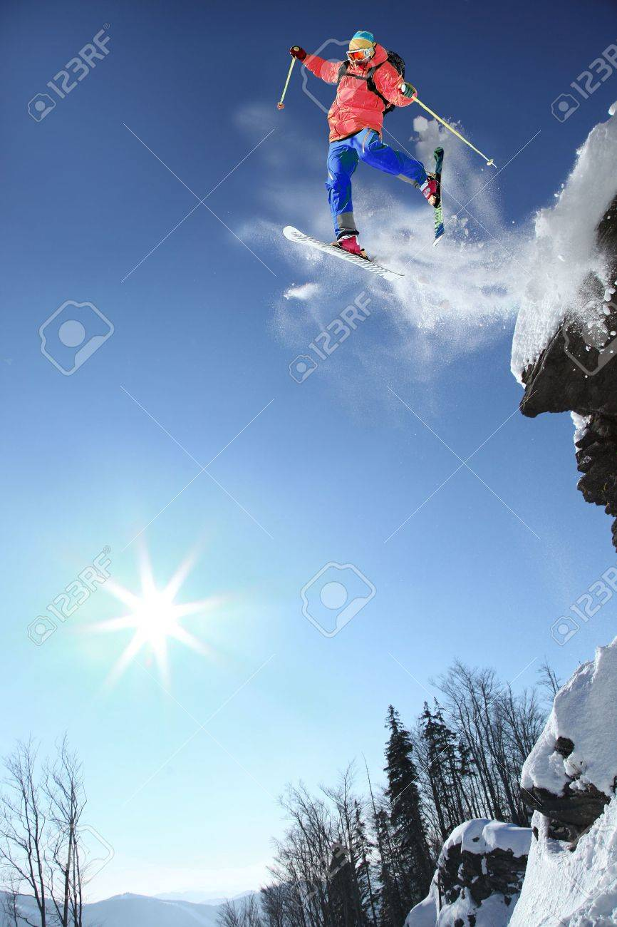 Skier jumping through the air from the rock - 15622099