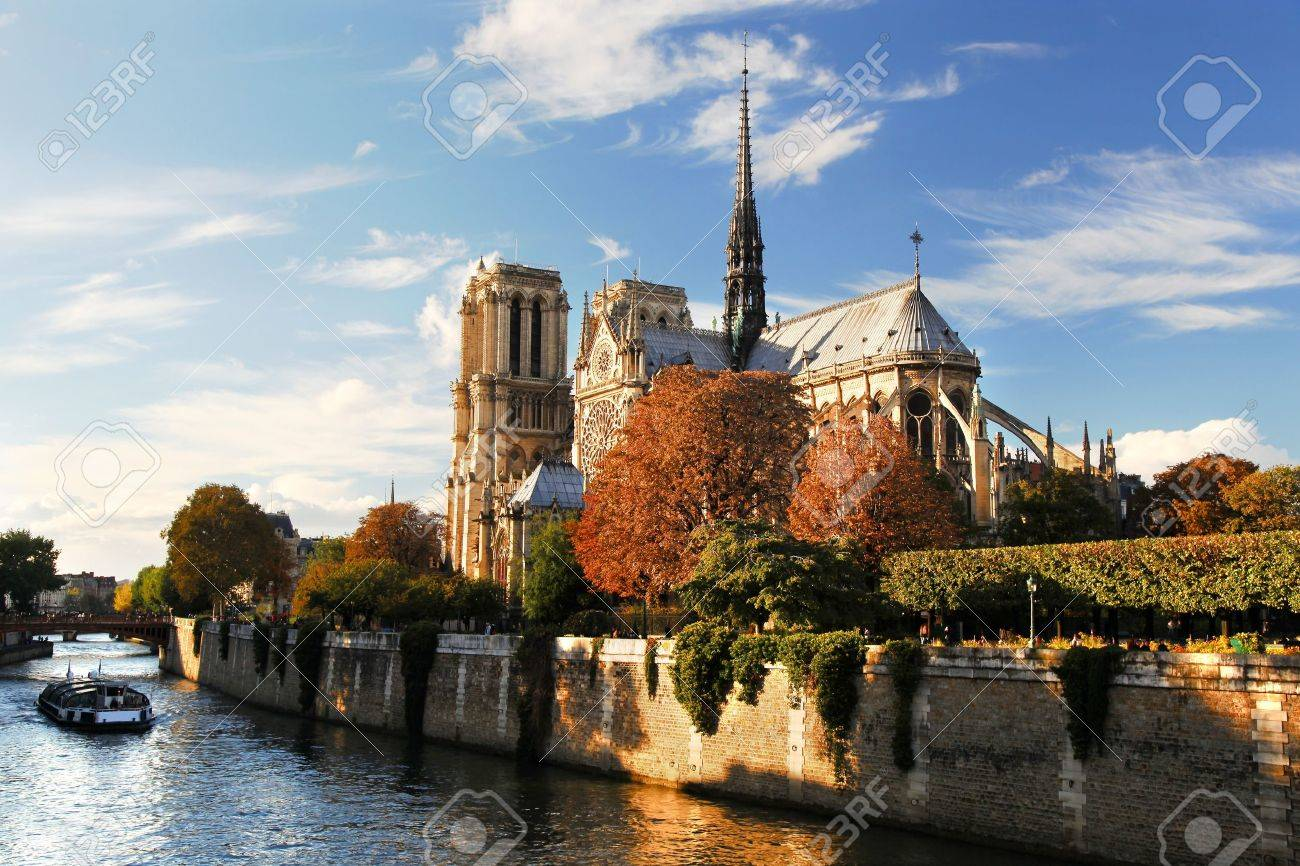 Notre Dame with boat on Seine in Paris, France - 15976514