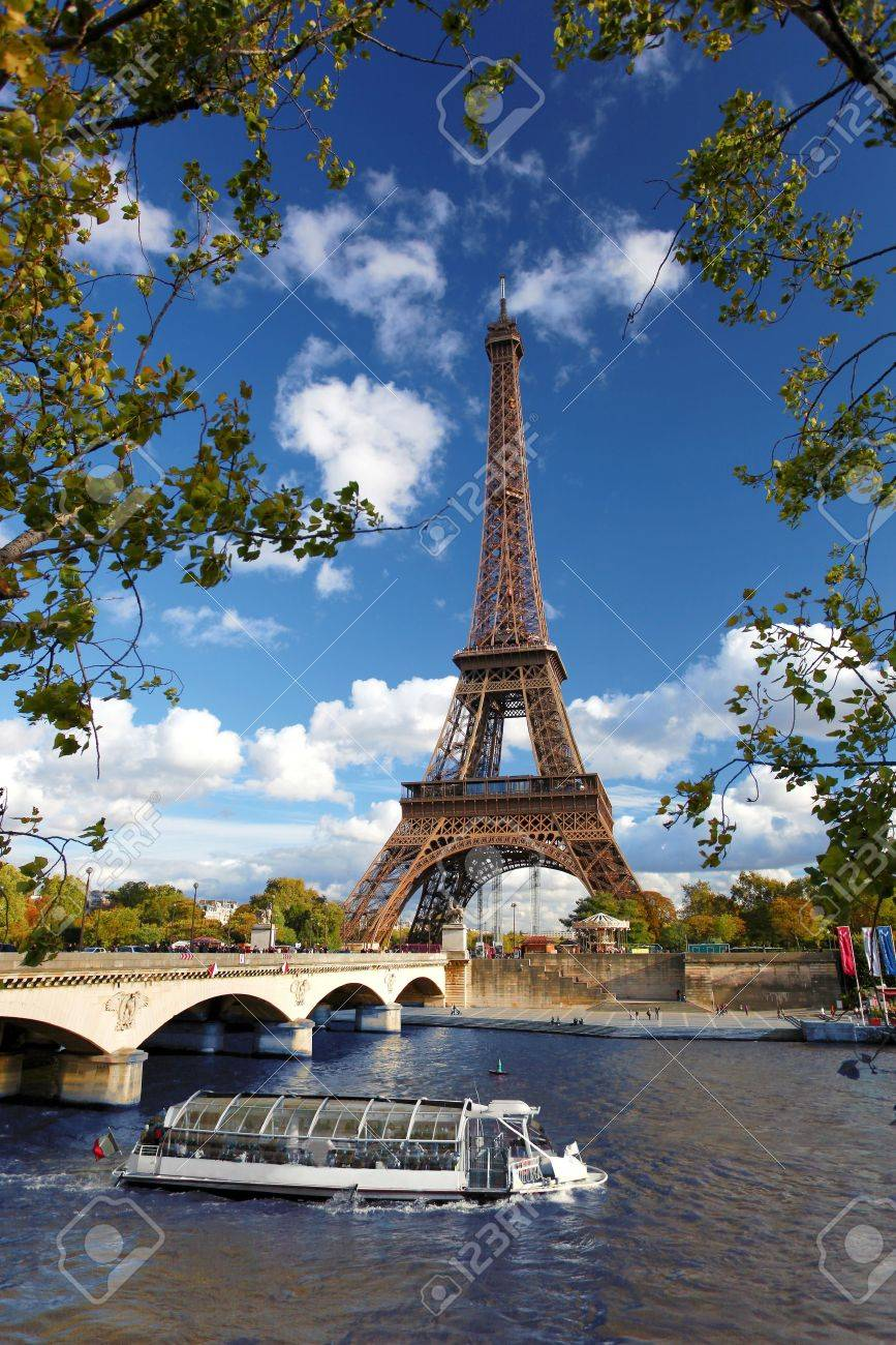 Eiffel Tower with boat in Paris, France - 16260151